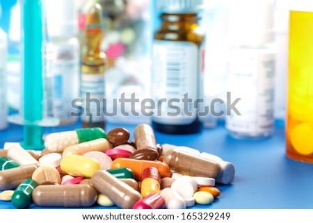 Medications-pills capsules and bottles - stock photo