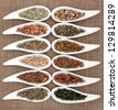 Medicinal herb selection also used in magical potions over hessian background. - stock photo