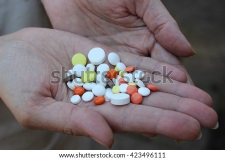 Medicinal pills on the palm. - stock photo