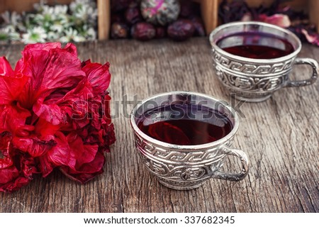 Medicinal tea decoction of hibiscus tea in stylish cups. - stock photo
