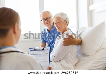 medicine, age, health care and people concept - senior woman, man and doctor with clipboard at hospital ward - stock photo