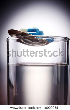 medicine and a glass of water