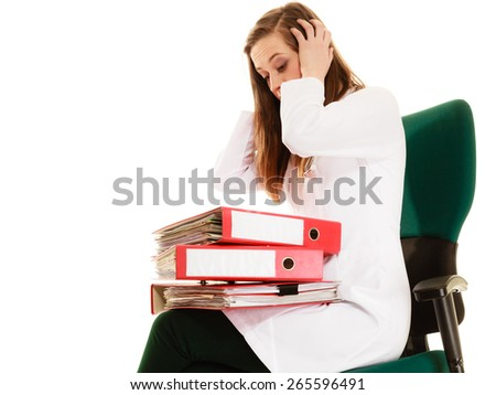 Medicine and paperwork. Tired overworked busy doctor woman with stack of folders with files documents isolated on white. - stock photo