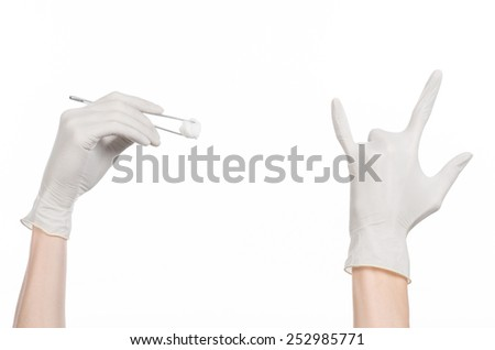 Medicine and Surgery theme: doctor's hand in a white glove holding tweezers with swab isolated on white background in studio - stock photo