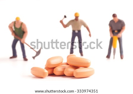 medicine and workmen, tablets medicine and workers, figurine isolated - stock photo