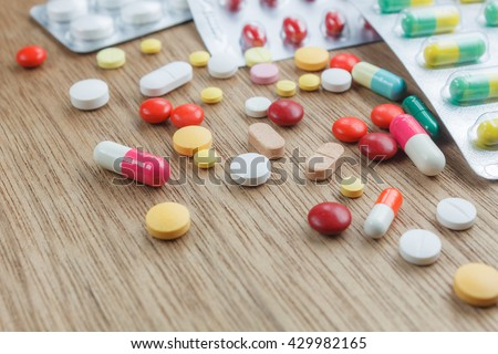 medicine background concept the medicine drugs, pills, capsule, tablets,drugs packaging on wood table  texture background. - stock photo