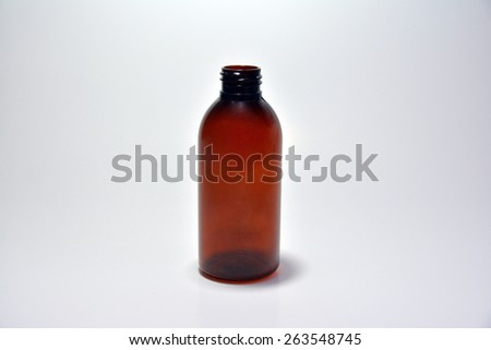medicine bottle or cosmetic product on gray background - stock photo