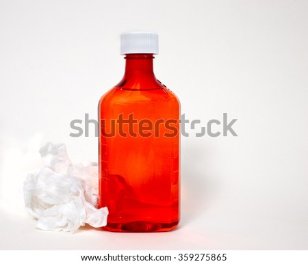 Medicine bottle with tissue on white background - stock photo