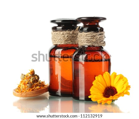 medicine bottles and calendula, isolated on white - stock photo