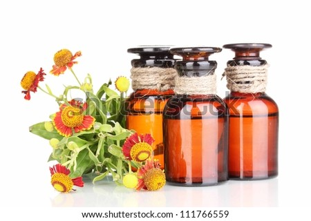 medicine bottles and flowers isolated on white - stock photo
