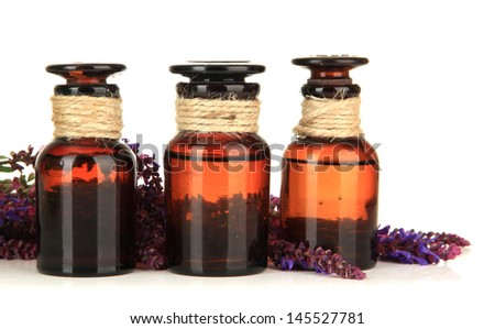 Medicine bottles and salvia flowers, isolated on white - stock photo