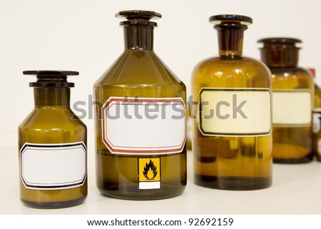 medicine bottles, blank labels, free copy space - stock photo