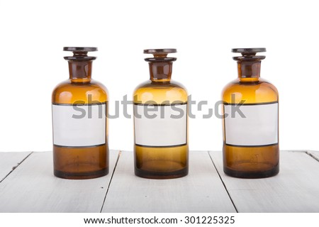 Medicine bottles with mint oil, buckthorn extract and may-lily tincture - stock photo