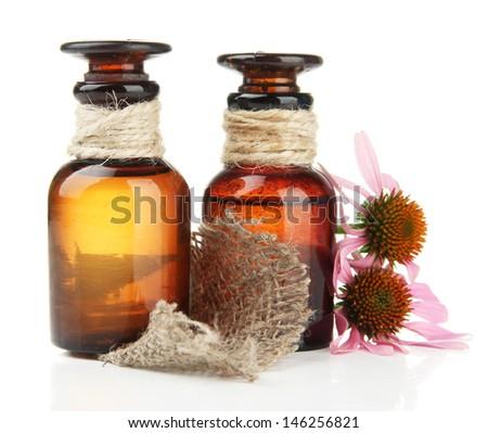 Medicine bottles with purple echinacea, isolated on white - stock photo