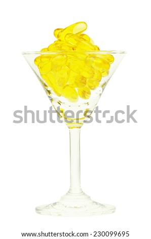 Medicine Capsule in Cocktail Glass isolated with Clipping Path. - stock photo