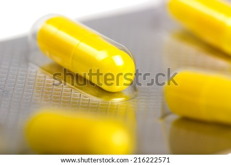 Medicine capsules packed in blisters isolated on white background - stock photo