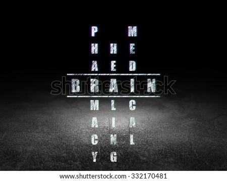 Medicine concept: Glowing word Brain in solving Crossword Puzzle in grunge dark room with Dirty Floor, black background - stock photo
