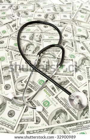 medicine concept. stethoscope lies on set of money
