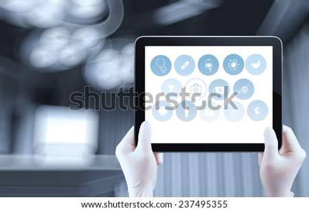 Medicine doctor hand shows tablet computer with medical computer interface as concept  - stock photo
