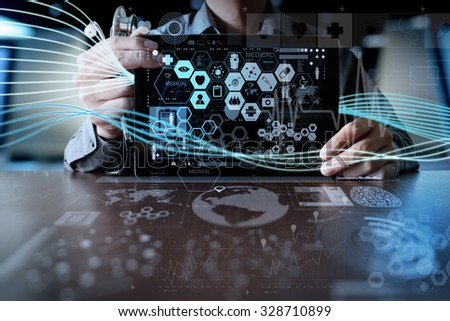 Medicine doctor hand working with modern computer interface and digital layer effect as medical network concept                                - stock photo