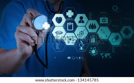Medicine doctor hand working with modern computer interface as medical concept - stock photo