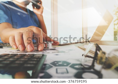 Medicine doctor hand working with modern computer with digital medical diagram on wooden desk as medical concept - stock photo