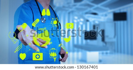 Medicine doctor working with modern computer interface as medical concept - stock photo