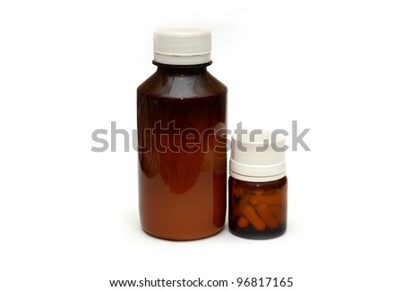 Medicine glass bottle with pills on white background