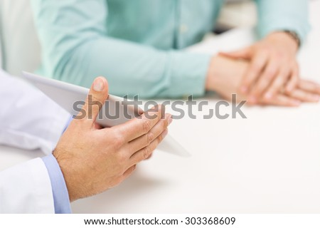 medicine, health care, people, prostate cancer and technology concept - close up of f male doctor and patient hands with tablet pc computer - stock photo