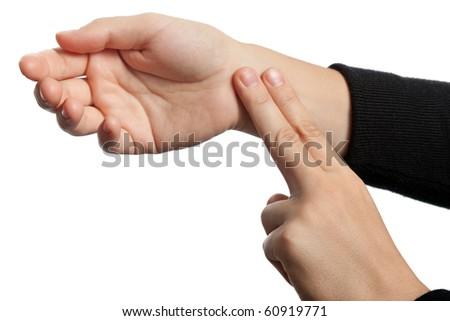 Medicine healthcare human hand measuring arm pulse - stock photo