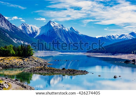 Medicine Lake is located within Jasper National Park, Alberta, Canada. It is located 20 km southeast of the townsite of Jasper, Alberta. Medicine Lake is 7 km long and is a shallow lake. - stock photo
