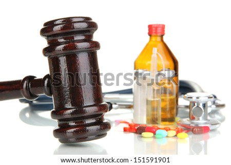 Medicine law concept. Gavel and pills isolated on white  - stock photo