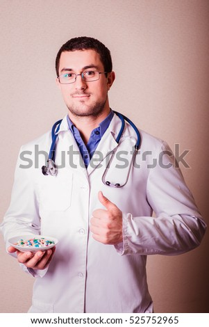 Medicine. Man, male doctor with pill in hand. Medical drug for health, healthcare. Care, pharmacy treatment in hospital. Physician with stethoscope. Capsule from disease