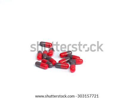 medicine on teaspoon  isolated - stock photo