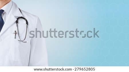 medicine, people and health care concept - close up of male doctor with stethoscope over blue background - stock photo