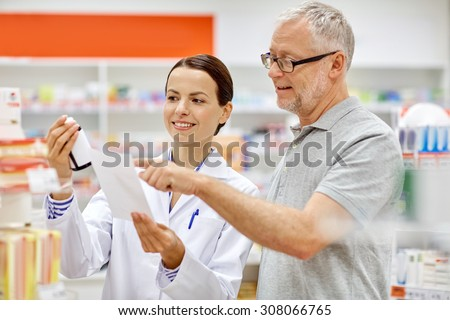 medicine, pharmaceutics, health care and people concept - happy pharmacist and senior man customer with drug and prescription at drugstore - stock photo