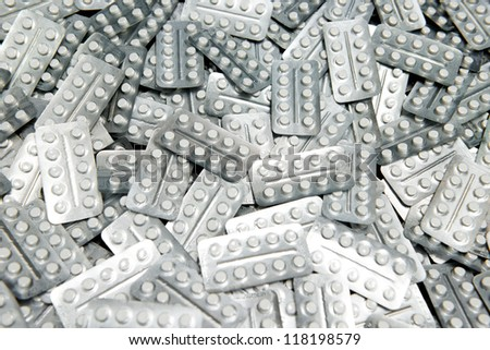 Medicine pharmacy tablet and pills in blister package heap background - stock photo