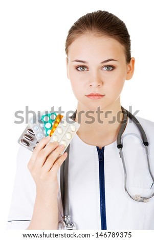 Medicine pills. Doctor or nurse showing medical pills,  isolated on white background.
