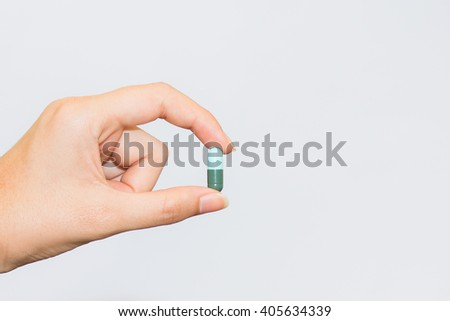 Medicine pills or capsules in hand, palm or fingers. Drug prescription for treatment medication. Pharmaceutical medication, cure in container for health. Antibiotic, painkiller close up. - stock photo