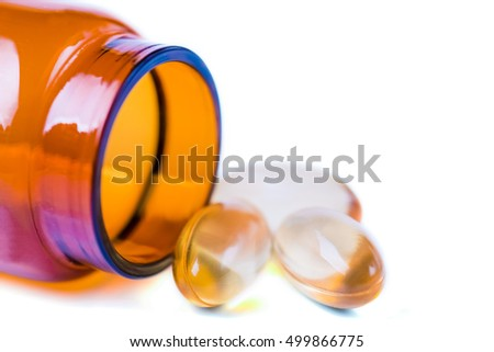 Medicine pills or capsules with bottle on white background. Drug prescription for treatment medication. Pharmaceutical medicament, cure in container for health. Injection with vaccine