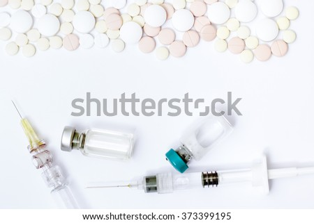 Medicine pills or capsules with syringe, bottle and thermometer on white background. Drug prescription for treatment medication. Pharmaceutical medicament, cure. Flu, temperature. - stock photo