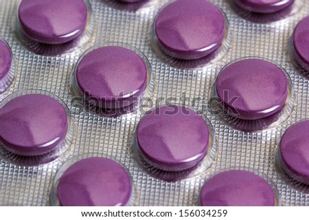 Medicine pills packed in blisters - stock photo