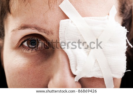 Medicine plaster patch on human injury wound eye - stock photo
