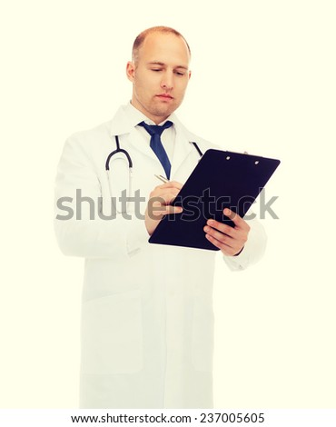 medicine, profession, and healthcare concept - serious male doctor with clipboard and stethoscope writing prescription over white background - stock photo