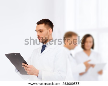 medicine, profession, and healthcare concept - serious male doctor with clipboard writing prescription over white background - stock photo