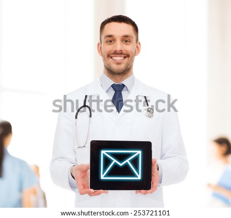 medicine, profession, and healthcare concept - smiling male doctor with tablet pc computer and stethoscope - stock photo