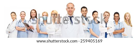 medicine, profession, teamwork and healthcare concept - international group of smiling medics or doctors with clipboard and stethoscopes with showing thumbs up over white background - stock photo