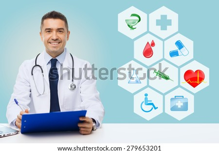 medicine, profession, technology and people concept - happy male doctor with clipboard and stethoscope over blue background with medical icons - stock photo