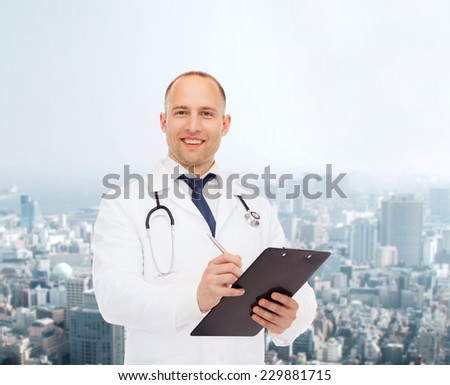 medicine, profession, urban life and healthcare concept - smiling male doctor with clipboard and stethoscope writing prescription over city background - stock photo