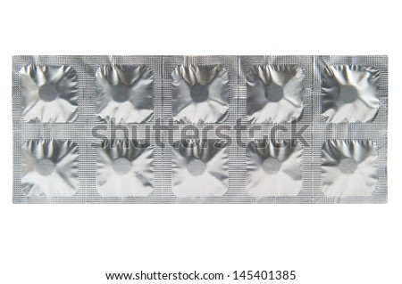 Medicine tablet in aluminum foil strip background - stock photo